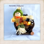 Miniature Scarecrow on Bench with Pumpkin