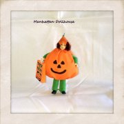 Dollhouse Doll dressed in a Pumpkin Halloween Outfit