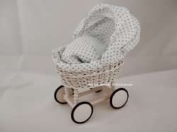 Miniature hand-made wicker bassinet