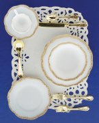 One Miniature Place Setting with a Gold Trim