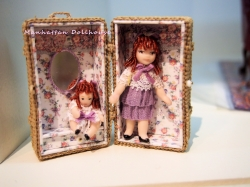 Two Pretty miniature dolls in their own wicker carrying case